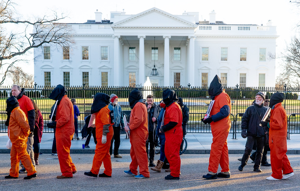 Guantanamo Bay protesters wearing prison jumpsuits in front of white house
