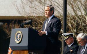 George W. Bush standing at podium